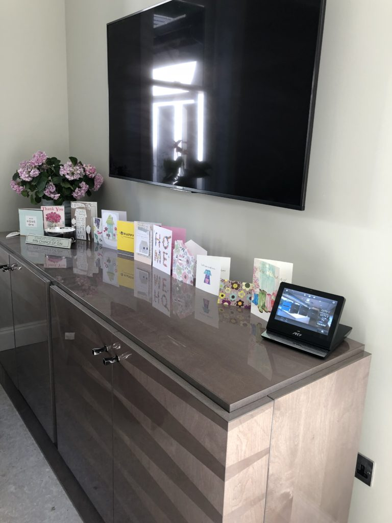 state-of-the-art upgrade Modern Mansion Renovation - rti touch screen control for not just the tv but the whole house