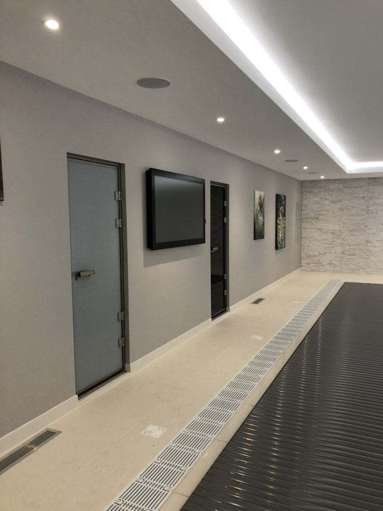Modern Mansion Renovation - aquavision horizon tv in the mansion pool complemented by sonance extreme series speakers
